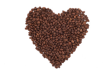 Coffee beans in a shape of hearth on white