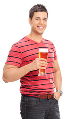 Vertical shot of a casual guy drinking beer