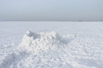 Unfinished snow construction of igloo