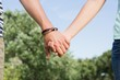 Cute couple in the park holding hands - 79071710