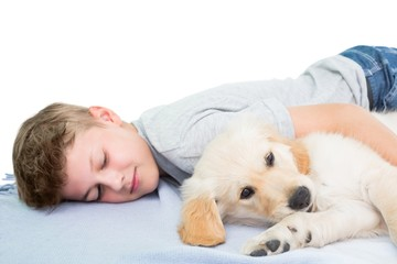 Boy sleeping with dog on blanket