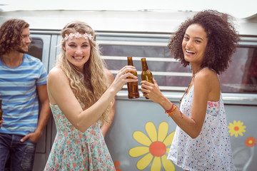 Pretty hipsters toasting with beer