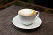 Cup of cappuccino over wooden table