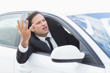 Businessman experiencing road rage