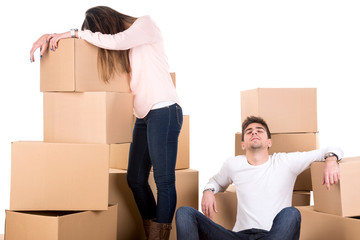Tired couple with boxes