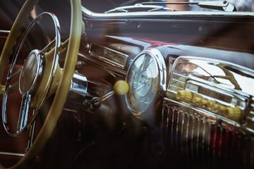 Dashboard and steering wheel in retro car interior