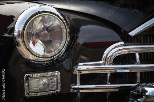 Old vintage car front lights or headlights Poster
