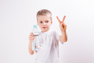 young boy drinking mineral water