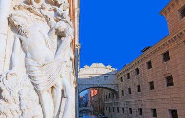 marble statue and the bridge of sighs in Venice