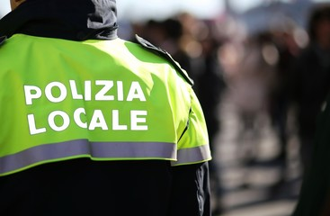Italian policeman with police uniform patrol the city