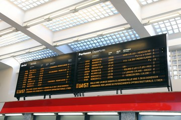 big Public transport timetable at a rail station in Italy
