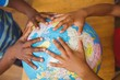 Hands on globe in classroom