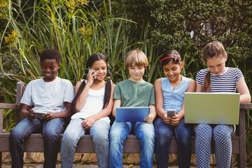Children using technologies at park