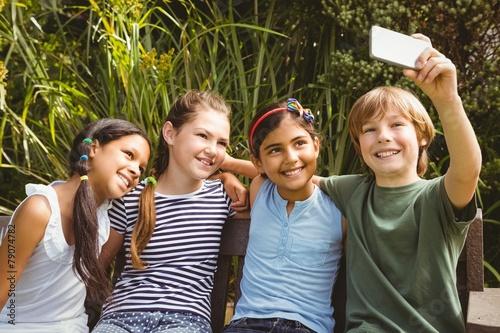 Papiers peints Attraction parc Happy children taking selfie at park