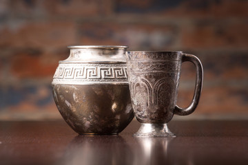 coffee cup and pot with arabic decoration with metal cup   on wo