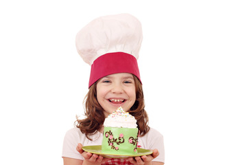 happy little girl cook with cupcake