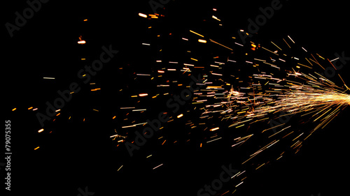 Leinwandbild Motiv Glowing Flow of Sparks in the Dark
