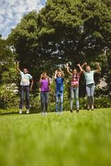 Children jumping at park