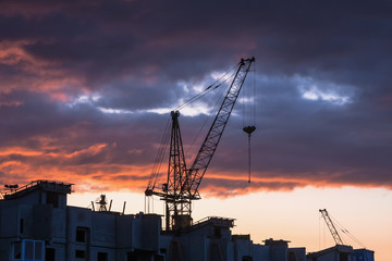 Silhouette of building crane