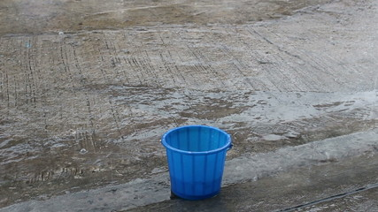 bucket slave rain water flowing down.