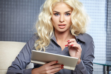 Smiling woman with a tablet computer