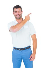 Smiling male technician pointing at copy space