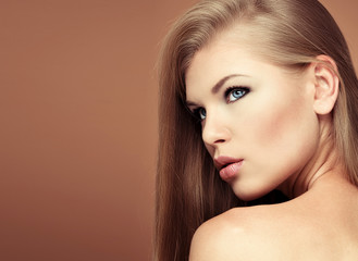 Long hair seductress with professional make up and hairstyle