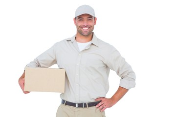 Confident delivery man with cardboard box on white background