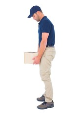 Delivery man carrying heavy package on white background