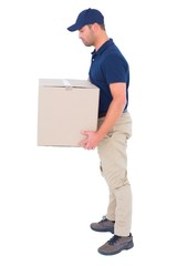 Side view of delivery man carrying cardboard box