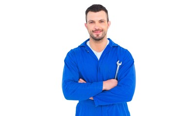 Happy mechanic holding spanner on white background