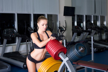 Sexy woman resting in gym