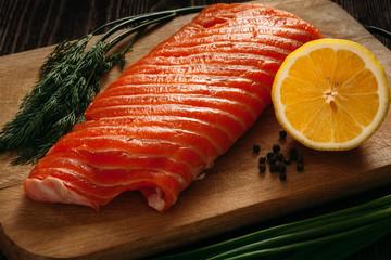 Fresh salmon piece on wooden board