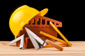 builder  tools on black background