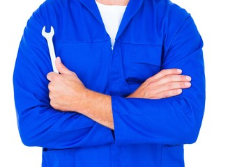 Male mechanic holding spanner on white background