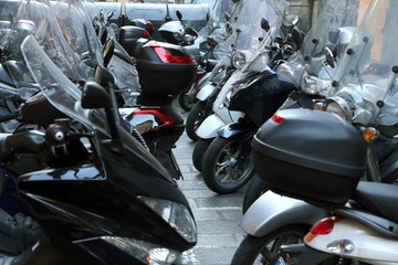 scooters and mopeds parked in illegal parking