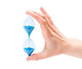 Woman's hand holding sand hourglass