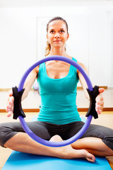 Fitness teacher making exercisese with the circle tool