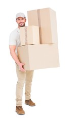Delivery man carrying cardboard boxes