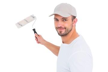 Handyman holding paint roller
