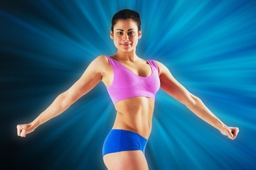 Composite image of fit brunette posing and looking at camera