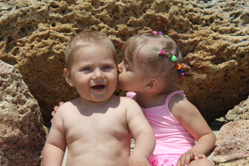 Little sister kissing her brother