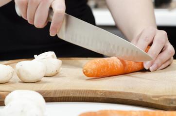 chopping carrots on a chopping board