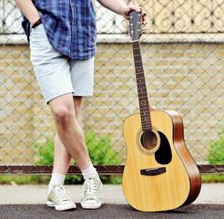 Man with guitar outdoor portrait