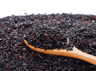 black rice in wooden spoon