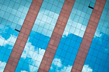 Blue Sky and Clouds Reflected in Modern Building Facade