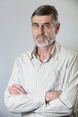 A portrait of a casual middle aged man in striped shirt