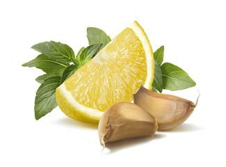 Lemon basil garlic segments pesto ingredient isolated on white b