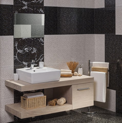 detail of a modern bathroom with white sink and towels