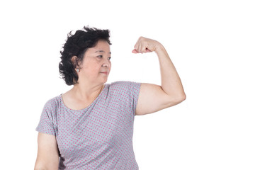 Strong Asian senior female showing off her biceps flexing muscle